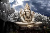 stock photo of shiva  - Big Lord Shiva statue sitting in lotus with trident in his hand and cobra near by - JPG