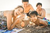 Asian family on vacation poster