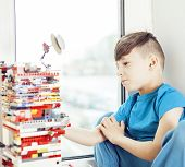 Little Cute Preschooler Boy Playing Lego Toys At Home Happy Smiling, Lifestyle Children Concept Clos poster