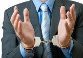 image of white collar crime  - White collar criminal under arrest - JPG