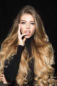 Gorgeous Long Hair. Sensual Woman In Black Clothes, Long Hair, Perfect Makeup, Long Eyelashes, Open  poster