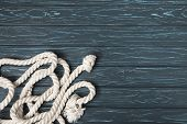Top View Of Knotted White Nautical Rope On Wooden Planks poster