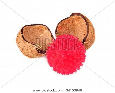 Coconut Shells With Red Ball Isolatet On A White Backround