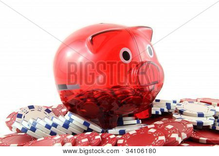 red and white poker chips with a piggy bank on a white background
