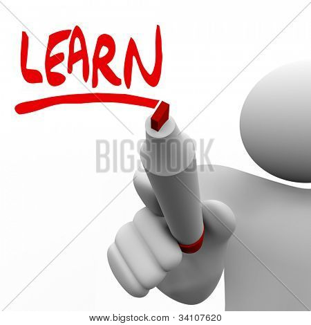 A teacher or leader writes the word Learn to inspire his class or team to gain new information and knowledge through education or how-to instruction