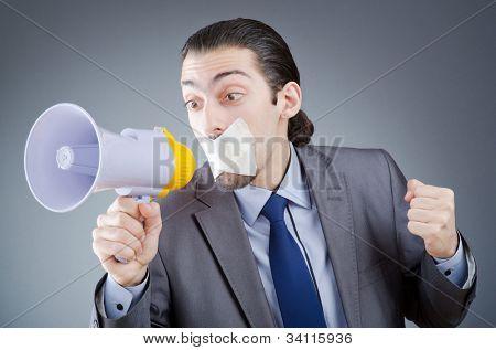 Businessman shouting via loudspeaker