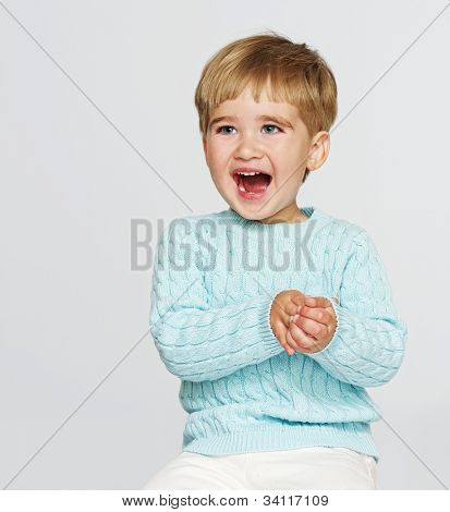 Happy baby boy in blue pullover