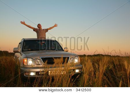 Man With Offroad Car In Field