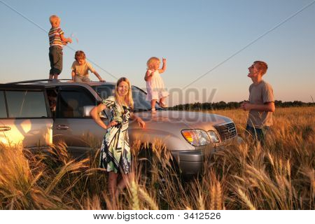 Family With Children On Offroad Car
