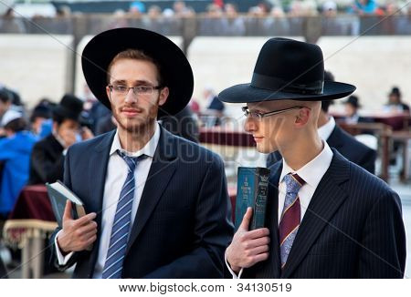 JERUSALEM,ISRAEL-APRIL 27:Unidentified jewish praying at the western wall on a jewish holiday on April 27. 2012.Jerusalem,Israel.April 27 celebrated as day when the state of Israel was proclaimed