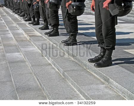 Police Cordon In Black Uniform With Hard Hat (helmet), Modern Security Details