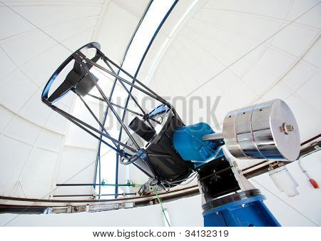 Astronomic observatory telescope inside a white dome