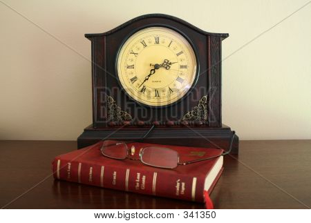 Clock Book And Spectacles