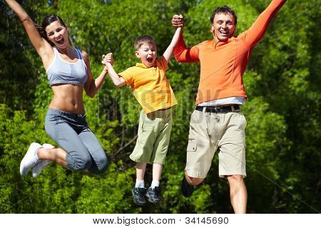 Simultaneous family jump manifesting love for life and vitality