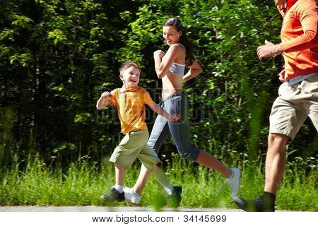 Happy running family proving the well-known saying �¢�?�?Life is motion�¢�?�