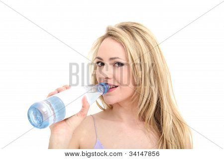Pretty Girl Smiles As She Drinks From A Bottle