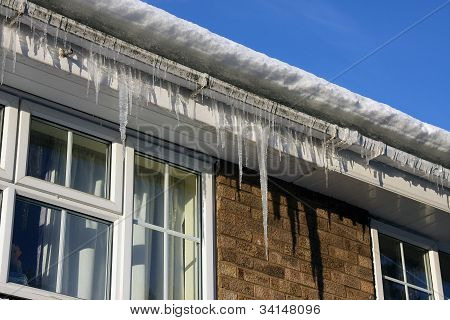 Icicles on house water guttering.