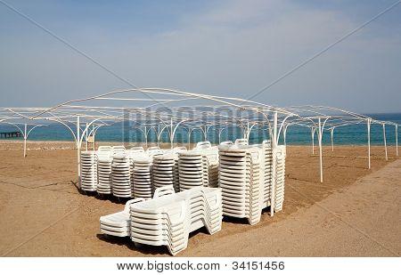 Empty Beach With Sun Lounger