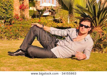 Man Posing In Sunglasses