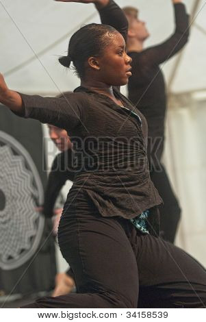 Teenager summersaulting on the life-sized Dancer,  perform live on the Global Community Stage at th