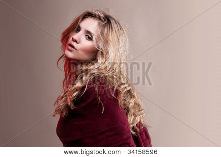 woman in jeans and red scarf