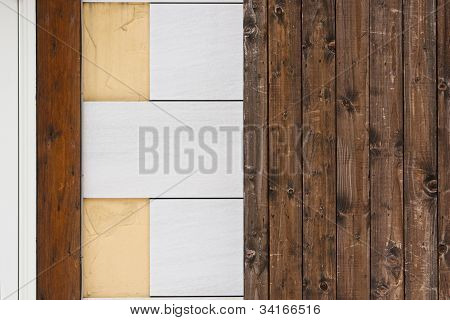 Wall from wood plank and fake stone tiles