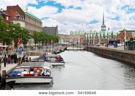 Small vessels in channel, building of Stock Exchange in Copenhagen, Denmark.