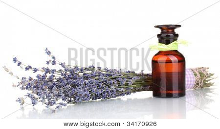 Lavender flowers and glass bottle isolated on white