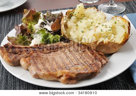 Grilled Rib Steak With Baked Potato