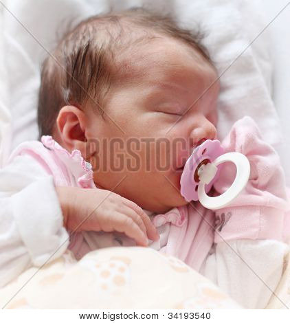 Cute baby sleeping on the bed.