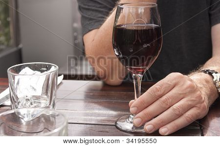 Glass Of Red Wine With Hand