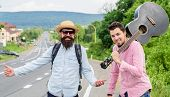 Begin Adventure. Travelers With Backpack And Guitar Ready To Strat New Journey. Men At Edge Of Road  poster