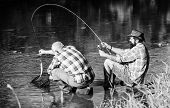 Fly Fish Hobby Of Men. Retirement Fishery. Retired Father And Mature Bearded Son. Two Male Friends F poster