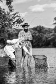 Family Is Best. Retired Dad And Mature Bearded Son. Catching And Fishing Concept. Happy Fishermen. G poster