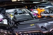 Under The Hood Of A Hybrid Or Electric Car. Detail Of Electric Car Engine. poster