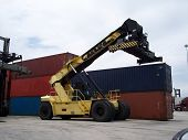 stock photo of hustler  - Shipping Yard container Top Loader used to mount containers on trucks and stacking containers in inventory - JPG