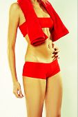 pic of partially clothed  - Woman In Red Active Wear Grabbing at Her Stomach - JPG