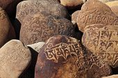 stock photo of mantra  - Tibetan Buddhist Mani Stones  - JPG