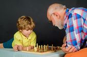 Child Boy Playing Chess With Grandfather. Games And Activities For Children. Checkmate. Little Boy T poster