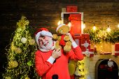 Santa Claus Man With Teddy Bear On Shoulders. Christmas Decoration. Happy New Year. Santa Man With T poster
