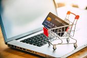 Small Shopping Cart With Credit Card On Laptop, Online Shopping And Shopping Concept poster