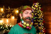 Bearded Man With Decorated Beard. Merry Christmas And Happy New Year. New Year Party. Smiling Santa  poster