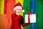 Unexpected Surprise. Surprise For New Year Holiday. Everyone Will Get A Present. Small Girl In Santa poster