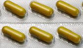 Brown capsules pill in blister pack arranged with beautiful pattern. Global healthcare concept. Anti poster