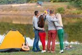 Picnic With Friends In At Lake Near Camping Tent. Company Friends Having Hike Picnic Nature Backgrou poster