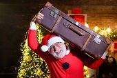New Years Travel. Santa Claus Hold Suitcase. Christmas Holiday. Travel, Tourist Trip, Vacation. Sant poster