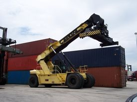 stock photo of boom-truck  - Shipping Yard container Top Loader used to mount containers on trucks and stacking containers in inventory - JPG