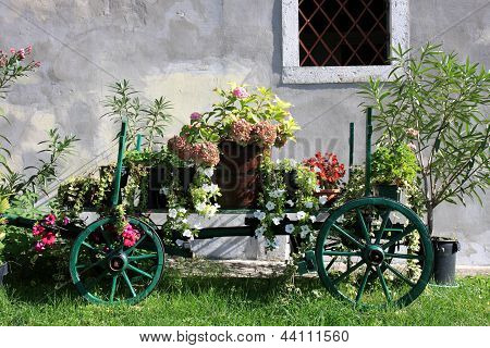 Old Wooden Cart With Colorful Flowers