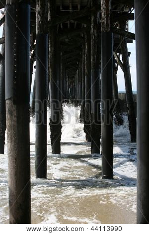 The Pacific Ocean under the Seal Beach Pier in Southern California USA