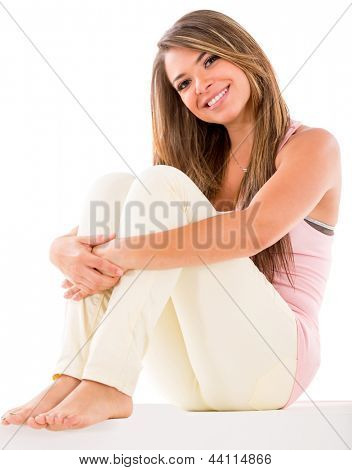 Beautiful woman casual sitting on the floor - isolated over white background